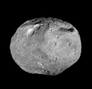 "Full View of Vesta. As NASA's Dawn spacecraft takes off for its next destination, this mosaic synthesizes some of the best views the spacecraft had of the giant asteroid Vesta. Dawn studied Vesta from July 2011 to September 2012. The towering mountain at the south pole -- more than twice the height of Mount Everest -- is visible at the bottom of the image. The set of three craters known as the ""snowman"" can be seen at the top left. More information about Dawn is online at http://dawn.jpl.nasa.gov."