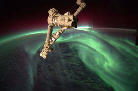 Earth's aurora in space. The Expedition 32 crew onboard the International Space Station, flying an altitude of approximately 240 miles, recorded a series of images of Aurora Australis, also known as the Southern Lights, on July 15. NASA astronaut Joe Acaba, flight engineer, recorded the series of images from the Tranquility node. The Canadarm2 robot arm is in the foreground.