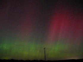The Aurora from Ithaca, NY. On October 28, 2003, one of the largest solar flares ever recorded sent a stream of high energy particles directly toward Earth, resulting in auroras that could be seen at low latitudes. A second flare led to auroras on the night of the 30th. This picture of the aurora was taken on Oct. 30, 2003 by Brian Kent, one of the Ask the Astronomer team members, at the Hartung-Boothroyd Observatory outside Ithaca. The Space Weather website has information about recent solar activity and can give you advance notice on when the aurora might be visible at your location.
