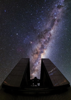 ESO's majestic telescope enclosure at La Silla aligns perfectly with the Milky Way's central region — the brightest section and the area which obscures the galactic centre. Visible to the left of the Milky Way is the bright orange star Antares at the heart of Scorpius (The Scorpion). Visible to the left of the Milky Way is the bright orange star Antares at the heart of Scorpius (The Scorpion).