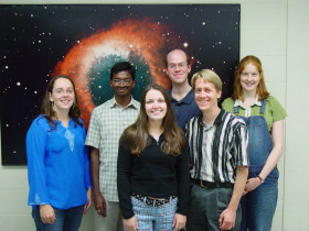 The Ask an Astronomer team, September 2004. Here some of us are lined up in Room 105 of the Cornell Space Sciences Building after the weekly Astronomy Colloquium. From left to right: Karen Masters, Jagadheep D. Pandian, Sabrina Steirwalt, Brian Kent, Marc Berthoud, Amélie Saintonge (and son, not yet visible). (Credit: Tim McConnochie)