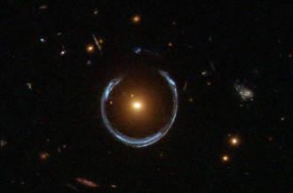 A Horseshoe Einstein Ring from Hubble. What's large and blue and can wrap itself around an entire galaxy? A gravitational lens mirage. Pictured above, the gravity of a luminous red galaxy (LRG) has gravitationally distorted the light from a much more distant blue galaxy. More typically, such light bending results in two discernible images of the distant galaxy, but here the lens alignment is so precise that the background galaxy is distorted into a horseshoe - a nearly complete ring. Since such a lensing effect was generally predicted in some detail by Albert Einstein over 70 years ago, rings like this are now known as Einstein Rings. (Credit: ESA/Hubble & NASA)