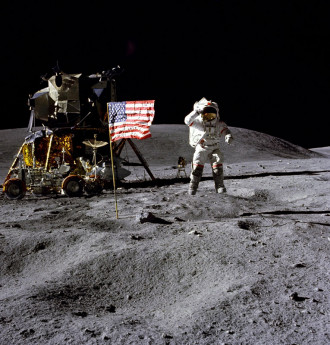 "John Young, astronaut and Navy veteran, salutes the U.S. flag at the Descartes landing site during the first Apollo 16 extravehicular activity (EVA-1). Young, commander of the Apollo 16 lunar landing mission, jumps up from the lunar surface as astronaut and Air Force veteran, Charles M. Duke Jr., lunar module pilot, took this picture. The Lunar Module (LM) ""Orion"" is on the left. The Lunar Roving Vehicle is parked beside the LM. The object behind Young in the shade of the LM is the Far Ultraviolet Camera/Spectrograph. Stone Mountain dominates the background in this lunar scene. (Credit: NASA, Charles M. Duke Jr.)"