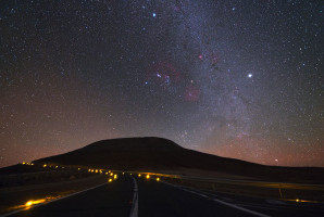Driving through the dark night at the road leading from the Residencia Hotel up to the top of Cerro Paranal, location of the VLT, is a challenging task. No lights besides parking lights are allowed for cars after sunset on the curved road. In the centre of the image, the constellation of Orion is clearly visible. (Credit: Y. Beletsky (LCO)/ESO)