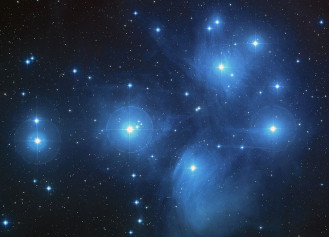 "The Pleiades Open Cluster. The Pleiades, an open cluster consisting of approximately 3,000 stars at a distance of 400 light-years (120 parsecs) from Earth in the constellation of Taurus. It is also known as ""The Seven Sisters"", or the astronomical designations NGC 1432/35 and M45. The color-composite image of the Pleiades star cluster was taken by the Palomar 48-inch Schmidt telescope."